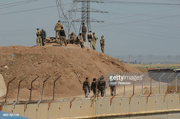 Iraqi Kurdish forces push the frontline forward against ISIS forces in the Tal alWard district 20 miles southwest of Kirkuk Iraq on March 13 2015...