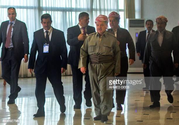 Iraqi Kurdish leader Massud Barzani arrives to cast his vote in the Kurdish independence referendum at a polling station near Arbil the capital of...