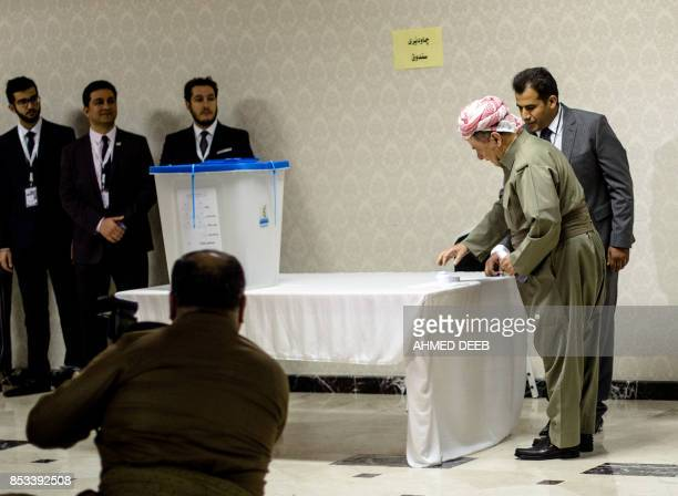 Iraqi Kurdish leader Massud Barzani casts his vote in the Kurdish independence referendum at a polling station near Arbil the capital of the...