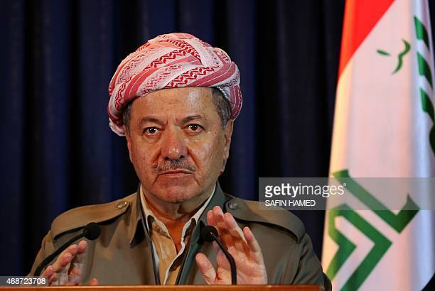 Iraqi Kurdish leader Massud Barzani gestures during a joint press conference with Iraqi Prime Minister Hadier alAbadi in Arbil the capital of the...