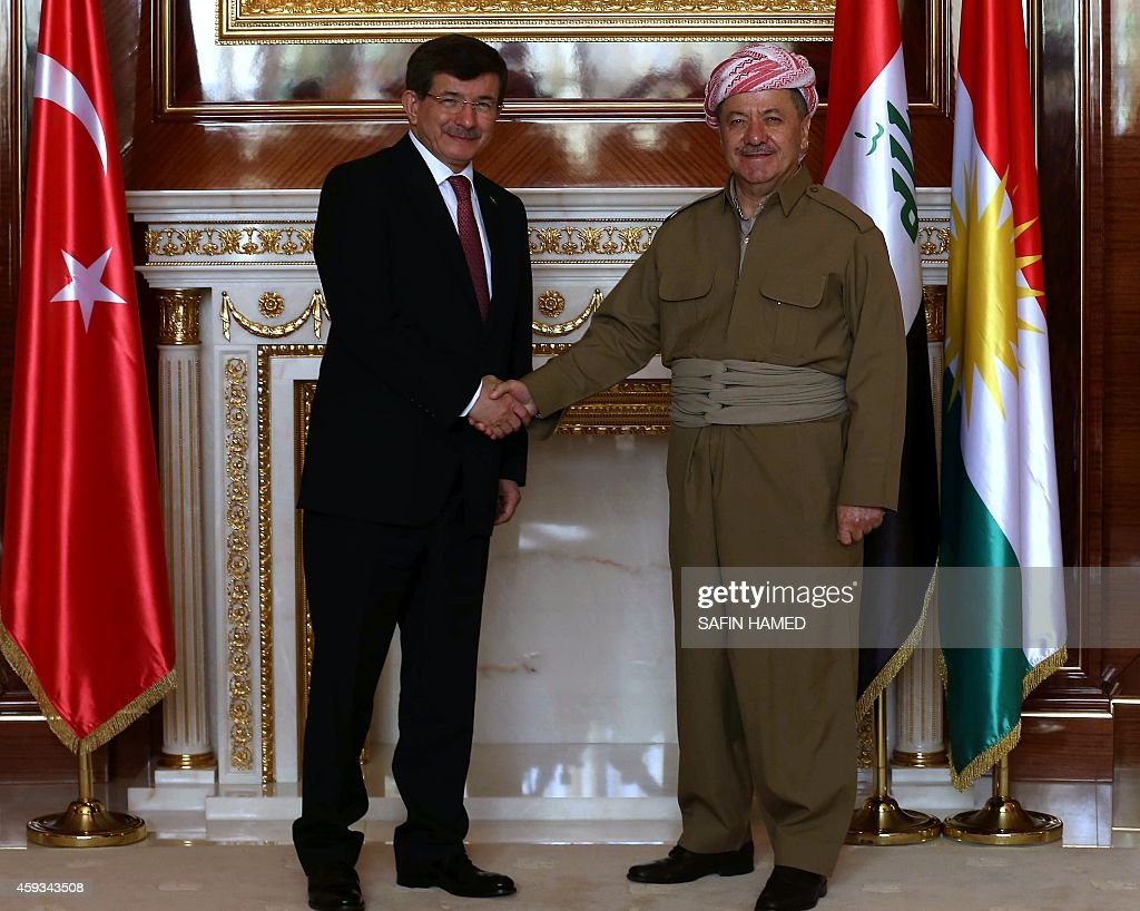 Iraqi Kurdish leader Massud Barzani (R) shakes hands with Turkish Prime Minister Ahmet Davutoglu during their meeting in Arbil, the capital of the Kurdish autonomous region in northern Iraq, on November 21, 2014. Davutoglu's trip to Iraq follows a visit to Turkey by Iraqi Foreign Minister Ibrahim al-Jaafari earlier this month that was aimed at patching up the chilly ties between the two neighbours.