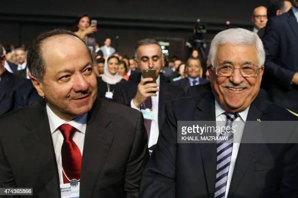 Iraqi Kurdish leader Massud Barzani sits next to Palestinian leader Mahmoud Abbas on the opening day of the World Economic Forum on the Middle East...