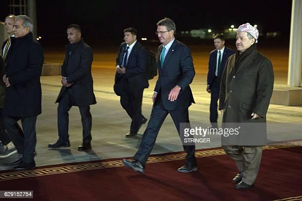 Iraqi Kurdish leader Massud Barzani walks with US Secretary of Defence Ashton Carter upon his arrival on December 11 in Arbil the capital of the...