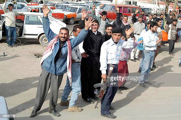 Iraqi Kurdish men celebrate 14 December 2003 the arrest of Iraqi toppled president Saddam Hussein US overseer Paul Bremer has confirmed the capture...