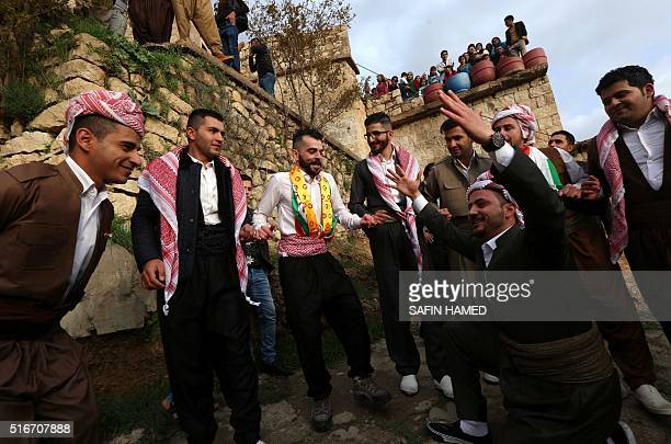Iraqi Kurdish men celebrate the Noruz spring festival with a traditional dance in the Kurdish town of Aqrah 500 kilometres north of Baghdad on March...