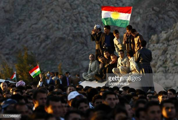 Iraqi Kurdish men holding Kurdish flags gather to celebrate new year which mark the beginning of the Noruz spring festival in the Kurdish town of...