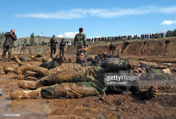 Iraqi Kurdish Peshmerga female officers perform drills as they take part in a graduation ceremony in the Kurdish town of Soran about 100 kilometres...