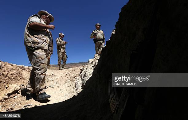 Iraqi Kurdish Peshmerga fighters guard a position at the frontline of fighting against Islamic State group's militants near the northern Iraqi town...