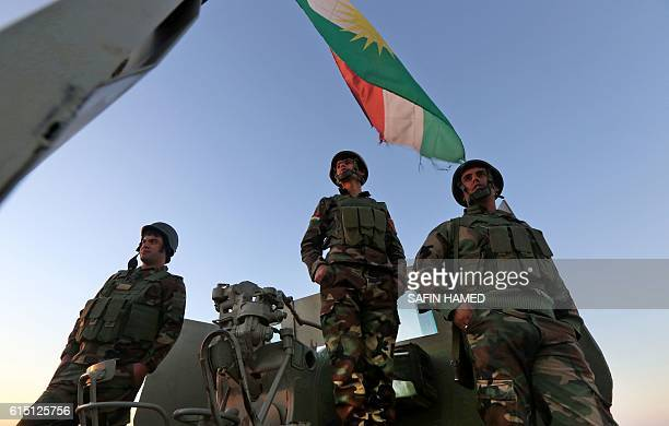 TOPSHOT Iraqi Kurdish Peshmerga fighters hold a position on the top of Mount Zardak about 25 kilometres east of Mosul on October 17 2016 Thousands of...