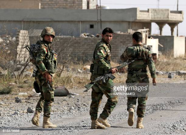 Iraqi Kurdish Peshmerga fighters patrol on October 18 2016 in the Shaqouli village about 35 kms east of Mosul after they've recaptured it from the...