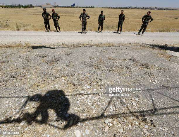 Iraqi Kurdish Peshmerga fighters take part in a training session in the grounds of their camp on June 23, 2014 in Arbil, the capital of the...