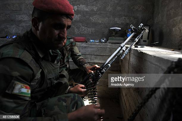 Iraqi Kurdish Peshmerga forces use ammunitions of Iraq's army to battle with the Islamic State of Iraq and the Levant in Karakus district of Mosul on...