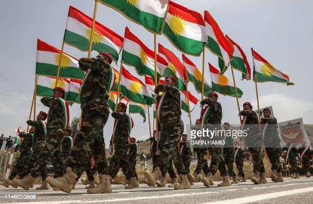 Iraqi Kurdish Peshmerga officers take part in a graduation ceremony in the Kurdish town of Soran 100 kilometres northeastern Arbil on May 25 2019