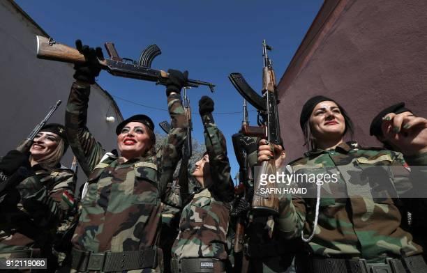 Iraqi Kurdish Peshmerga take part in a graduation ceremony at the Zakho military academy in the Iraqi Kurdish town of Zakho, some 500 kilometres...