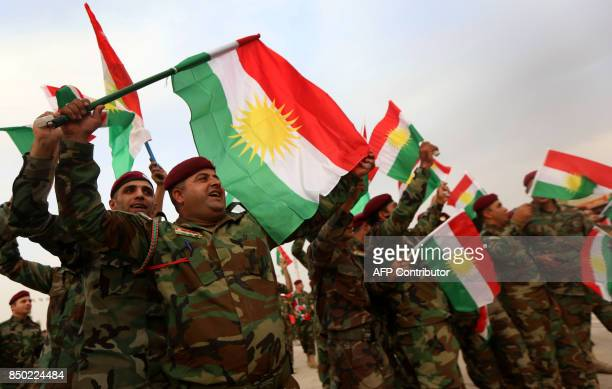 Iraqi Kurdish peshmergas take part in a gathering to urge people to vote in the upcoming independence referendum in Arbil the capital of the...