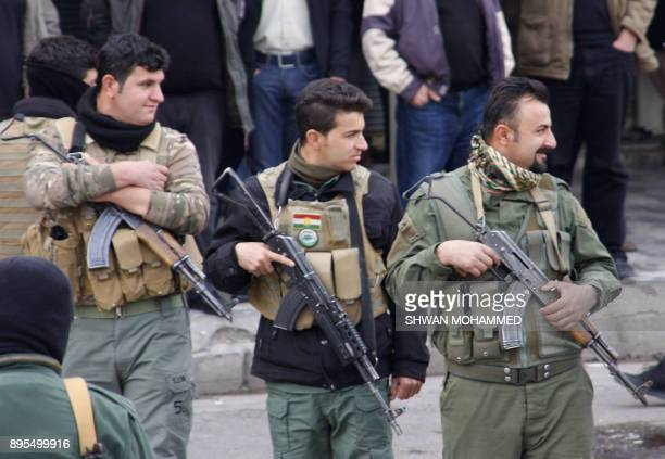 Iraqi Kurdish security forces stand guard during a protest in Sulaimaniyah in the Kurdish autonomous region of northern Iraq on December 19 2017 Five...