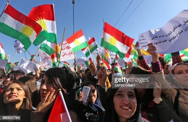 Iraqi Kurdish students of the Salahaddin University wave the Kurdish flag as they demonstrate in Arbil the capital of autonomous Iraqi Kurdistan...