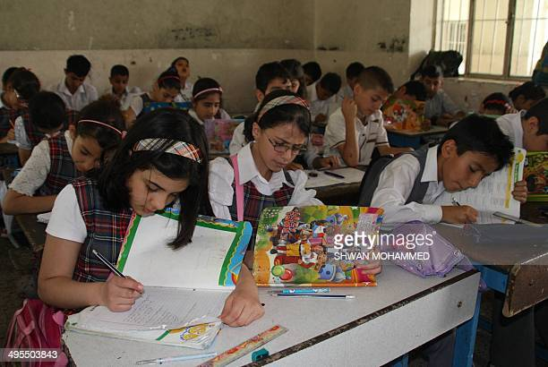 Iraqi Kurdish students sit at the Jawhery School during an Arabic language course on May 6 2014 in Sulaimaniyah AFP PHOTO / SHWAN MOHAMMED