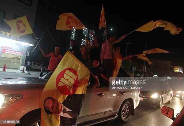 Iraqi Kurdish supporters of Massoud Barzani president of Iraq's autonomous Kurdish region and leader of the Kurdistan Democratic Party wave the KDP...