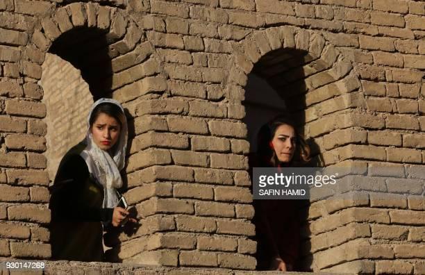 Iraqi Kurdish women attend a music concert at the Arbil citadel on March 10 in Arbil the capital of the Kurdish autonomous region in northern Iraq /...