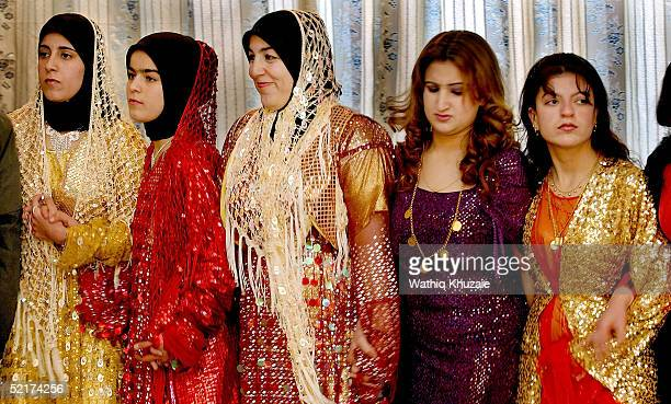 Iraqi Kurdish women wearing Kurdish outfits dance a traditional dance at a wedding party on February 10 2005 in Suleimaniya Iraq With just over half...