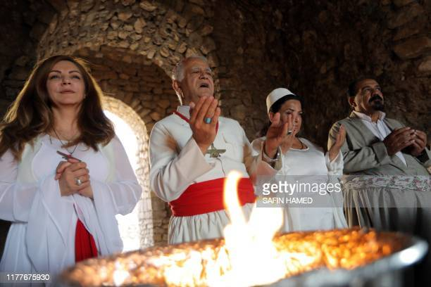 Iraqi Kurdish Zoroastrian take part in a ritual ceremony in an ancient and ruined temple of the Zoroastrian religion in the Iraqi Kurdish town of...