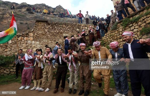Iraqi Kurds dressed in traditional clothing dance in the town of Akra 500 km north of Baghdad on March 20 2017 as they celebrate the Noruz spring...