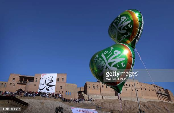 Iraqi Kurds fly heartshaped ballons in front of the citadel of Arbil the capital of the autonomous Kurdish region of northern Iraq on the eve of...