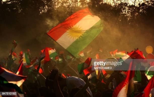 TOPSHOT Iraqi Kurds fly Kurdish flags during an event to urge people to vote in the upcoming independence referendum in Arbil the capital of the...