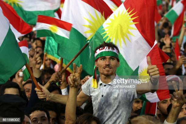 Iraqi Kurds fly Kurdish flags during an event to urge people to vote in the upcoming independence referendum in Arbil, the capital of the autonomous...