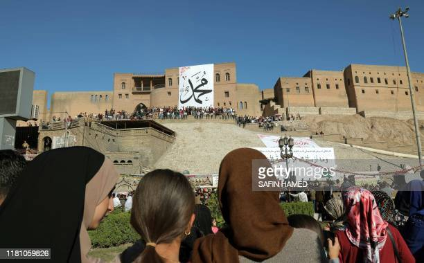 Iraqi Kurds gather around the citadel of Arbil the capital of the autonomous Kurdish region of northern Iraq on the eve of celebrations marking the...
