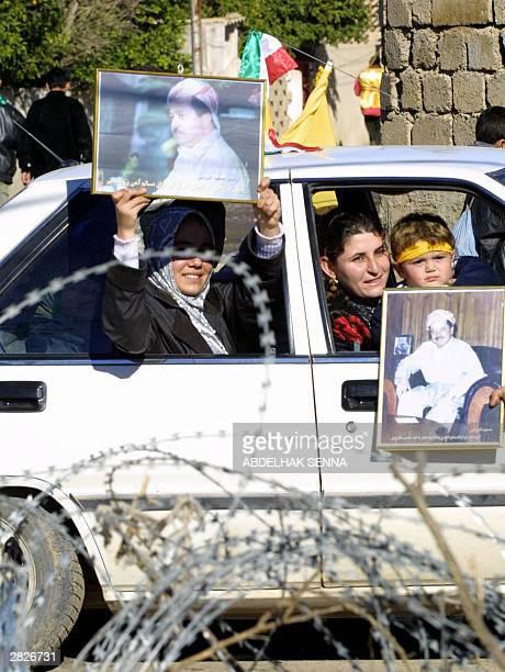 Iraqi Kurds hold up pictures of Massoud Barzani leader of Kurdistan Democratic Party during a demonstration in Kirkuk 255 kilometres north of Baghdad...
