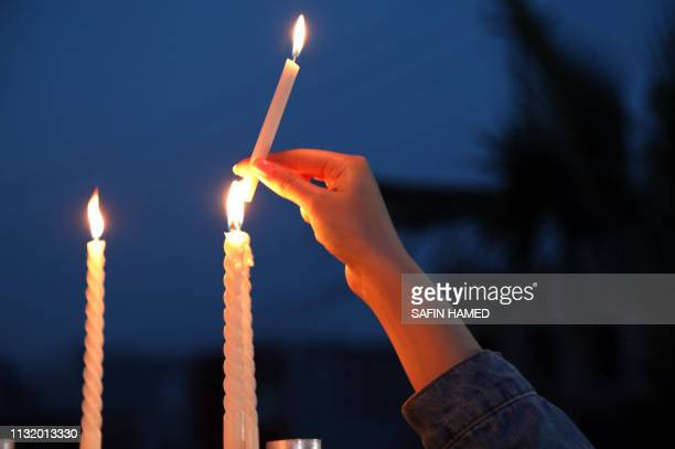 Iraqi Kurds light up candles in Arbil the capital of the Kurdish autonomous region in northern Iraq on March 22 in remembrance for the victims of the...