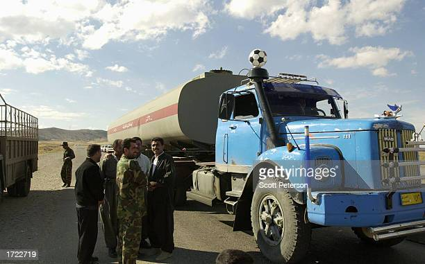 Iraqi Kurds of the Patriotic Union of Kurdistan one of two main Kurdish factions with selfrule in northern Iraq check an oil truck for contraband as...