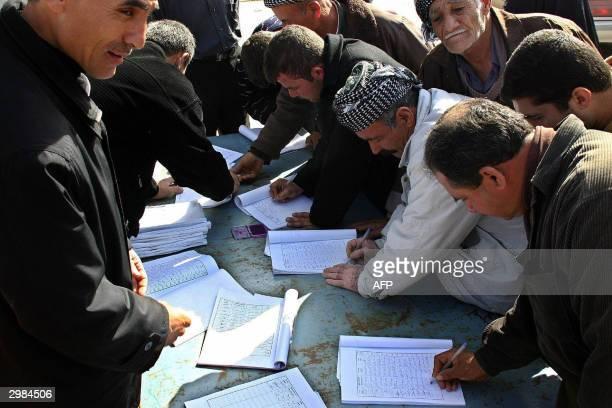 Iraqi Kurds sign a petition prepared by the two major Kurdish parties the Kurdish Democratic Party led by Massud Barzani and Jalal Talabani's...
