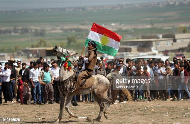 TOPSHOT Iraqi Kurds take part in a cultural festival near Maqlub Mountains 30 km northeast of Mosul on April 5 2018 / AFP PHOTO / SAFIN HAMED