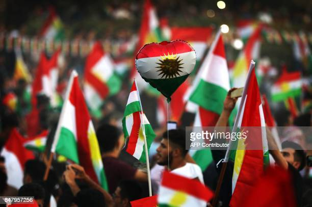 Iraqi Kurds take part in an event to urge people to vote in the upcoming independence referendum in Arbil the capital of the autonomous Kurdish...