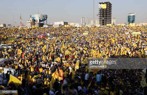 Iraqi Kurds wave flags as they attend an electoral rally for the Kurdistan Democratic Party at the Franco Hariri Stadium in Arbil the capital of the...