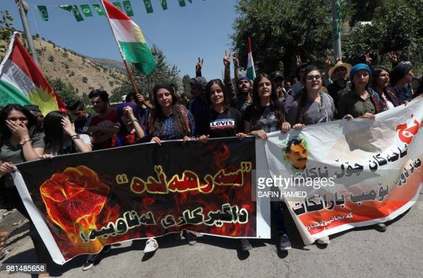 Iraqi Kurds wave Kurdish flags during a demonstration to protest a military operation by the Turkish army against the Kurdistan Workers' Party in the...