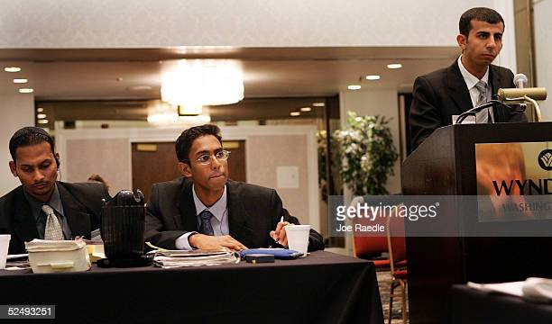 Iraqi law student Rebaz Khurshed Mohammed argues his point as Sri Lanken law students Lankanath Rathnayake and his teammate Suren Gnanaras listen...