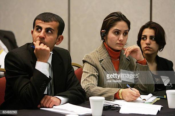 Iraqi law students Rabaz Khurshed Mohammed Zrian Jamal Hamid and Paiwagt Arif Maruf listen to the team from Sri Lanka make their arguments during the...