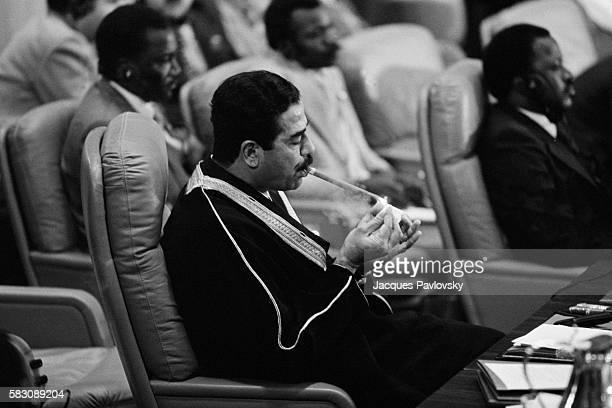 Iraqi Leader Saddam Hussein Smoking Cigar at the Taef Summit
