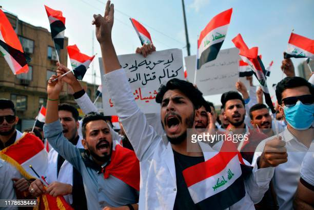 Iraqi medical students take part in an antigovernment demonstration in the central holy shrine city of Najaf on October 28 2019 Students and school...