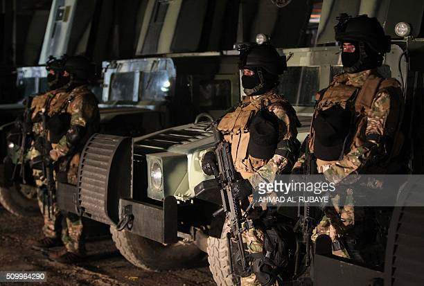 Iraqi members of the Special Weapons and Tactics team stand at the Habbaniyah camp south of the town of alHabbaniyah after a graduation ceremony on...