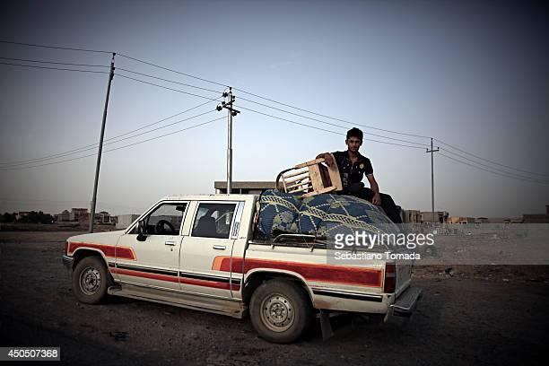 Iraqi men fleeing violence arrive at a Kurdish checkpoint.June 12, 2014.