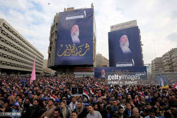 Iraqi men gather as Shiite Muslim leader and head of Hikma party Ammar alHakim speaks during the commemoration of the killing of the Shiite cleric...
