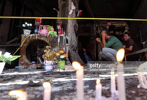 Iraqi men gather on July 7 2016 at a memorial for the victims of a bombing which claimed the lives of over 200 people in Baghdad's Karrada...