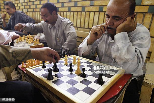 Iraqi men play chess at tea shop April 6 2006 in Baghdad Iraq According to the US Military Muhammed Hila Hammad Ubaydi a top aid to AlQaeda's top man...