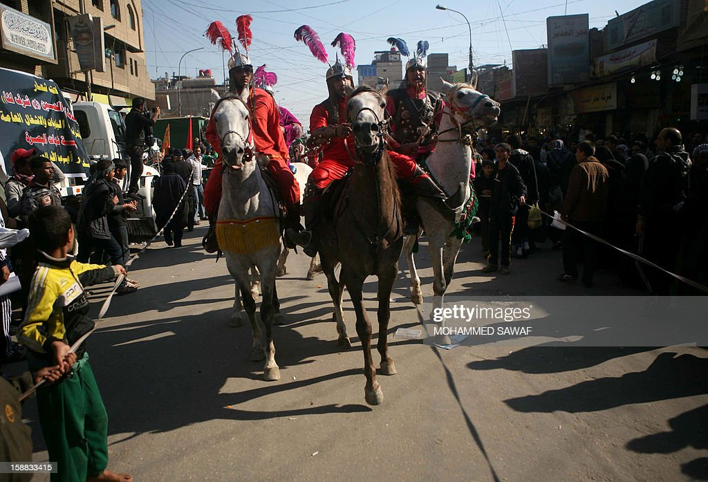 Iraqi men ride horses as they take part in the Arbaeen religious festival which marks the 40th day after Ashura commemorating the seventh century killing of Prophet Mohammed's grandson, Imam Hussein, in the shrine city of Karbala, southwest of Iraq's capital Baghdad, on December 31, 2012. A wave of bombings and shootings killed 12 people as Iraq grappled with anti-government protests and simmering political crises ahead of major Shiite Muslim commemoration rituals.