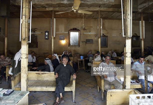Iraqi men sit in an old tea shop April 6 2006 in Baghdad Iraq According to the US Military Muhammed Hila Hammad Ubaydi a top aid to AlQaeda's top man...